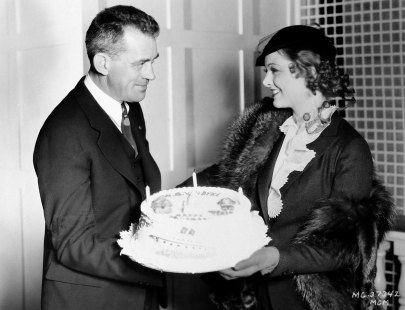myrna-loy-presents-w.s.-van-dyke-with-a-birthday-cake-on-the-set-of-manhattan-melodrama