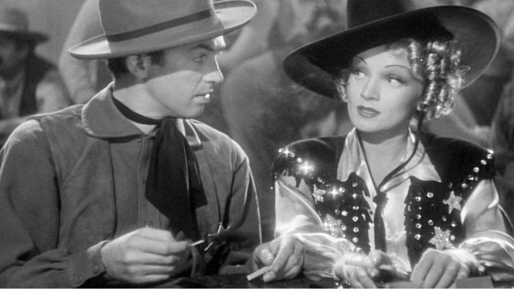 Marlene Dietrich and Jimmy Stewart in Destry Rides Again