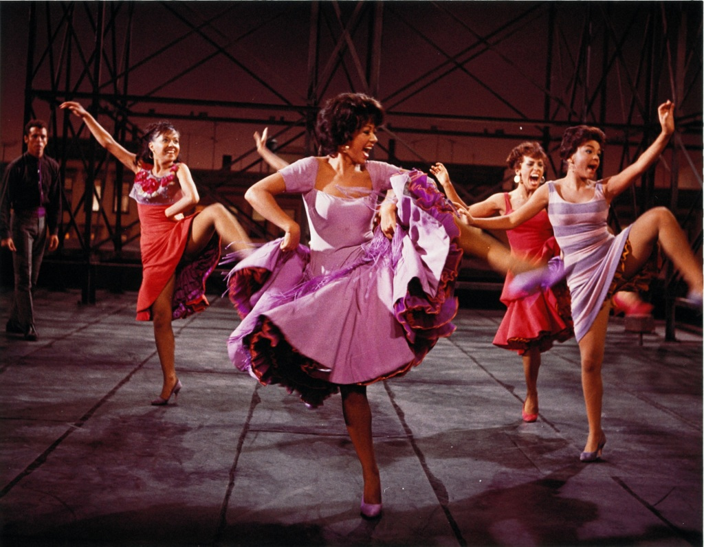 Rita Moreno dancing in the America number from West Side Story.