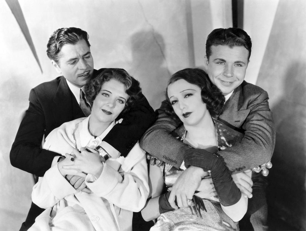 Warner Baxter, Ruby Keeler, Dick Powell, and Bebe Daniels.