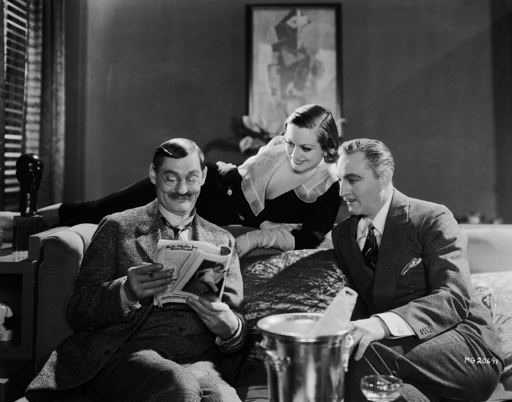 Lionel Barrymore, Joan Crawford, and John Barrymore in Grand Hotel.